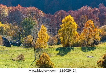 Dirty Secondary Road To Mountain Pass In Autumn Carpathian Mountains And Multicolored Yellow-orange-