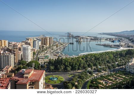City Skyline And Harbour, Sea Port Of Malaga Overlooking The Sea Ocean In Malaga, Spain, Europe On A