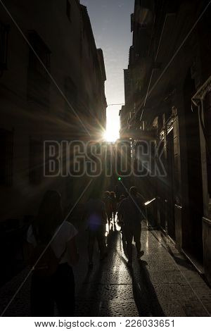 The Golden Sun Sets Across The Streets Of Malaga, Spain, Europe