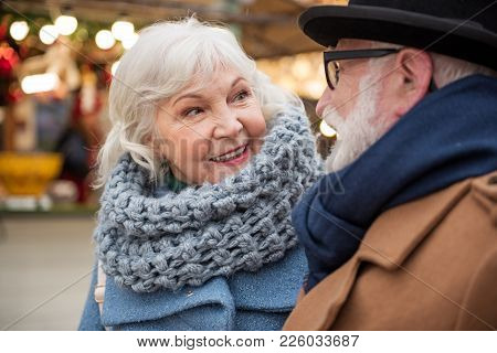 Portrait Of Happy Old Woman Dating With Man On Street. She Is Looking At Him With Fondness And Smili