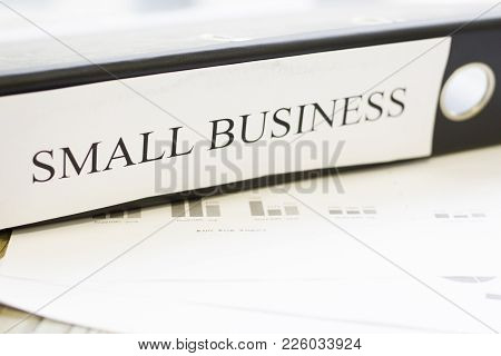 Modern Technology And People Concept - Small Business Documents. Rough Bords Background. Closeup