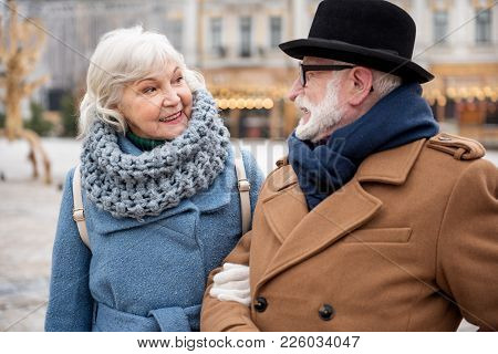 Portrait Of Cheerful Old Woman Enjoying Walk With Her Husband. They Are Talking And Laughing. Winter