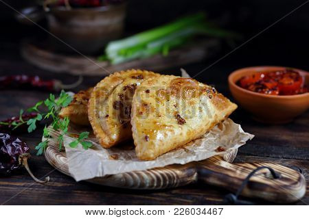 Fried Pies With Meat And Spices On The Table