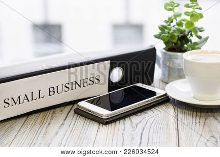 Planning Business Concept - Small Business Documents And Telephone. Rough Bords Background. Closeup