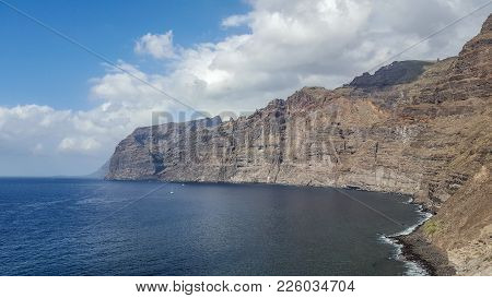 Los Gigantes Coastline With Volcanic Cliffs In Tenerife, Canary Island