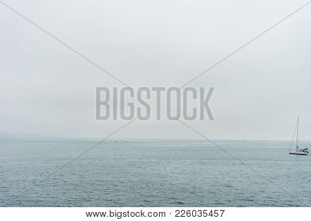 A Lonely Boat In The Sea At Malaga, Spain, Europe