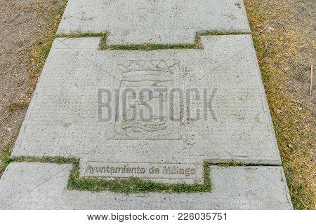 Inscription On A Stone Step At Malagueta Beach In Malaga, Spain, Europe On A Foggy Morning