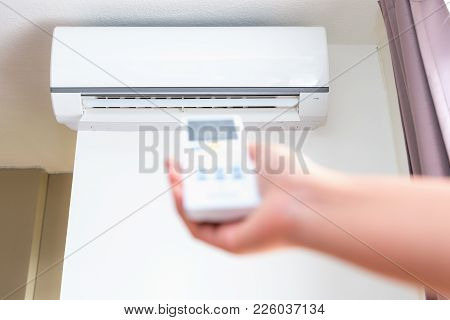 Split Type Air Conditioner And Remote Controller.
