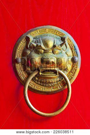 Old Door Handle In The Form Of A Metal Lion