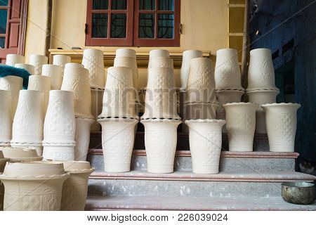 Processing Pottery Vase Drying In Bat Trang Ancient Ceramic Village. Bat Trang Village Is The Oldest