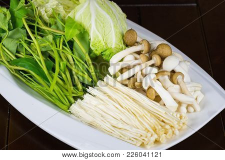 Close Up Vegetable For Hot Pot On White Dish