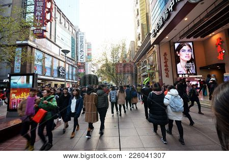Shanghai, China- Dec 26, 2017: On Nanjing Road Pedestrian Street - Modern Buildings In Western Archi