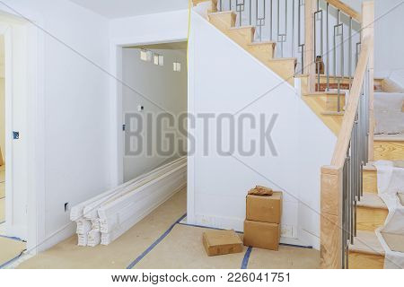 Brand New House Construction Interior Room With Unfinished Wood Floors. Partially Unfinished. Railin