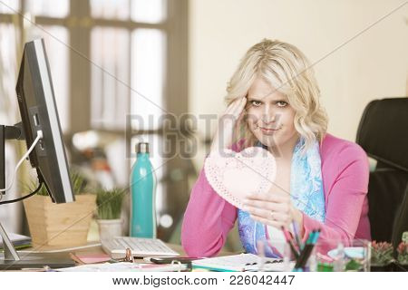 Upset Professional Woman With An Unwanted Valentine Heart