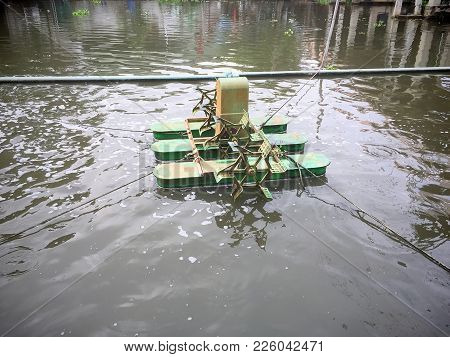 Old Green Aerator Floating On The Water