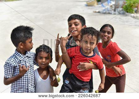 Maafushi Island,maldives - June 13 2017: Children Group Playing On The Beach  In Maafushi Island,mal