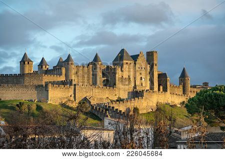 Walls And Towers Of Carcassonne In Light Of Setting Sun, Aude, France