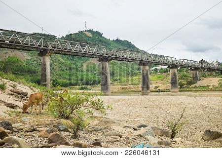 Central Highland Tay Nguyen Scene In Vietnam With Old Bridge Over Dry River