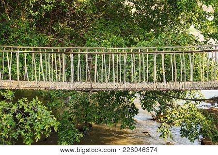 Walking Suspense Bridge Made Of Dry Bamboo In Tay Nguyen, Central Highlands Of Vietnam, Asia