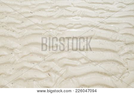 Wet Sand At Beach Coastline Texture Background.wave Form