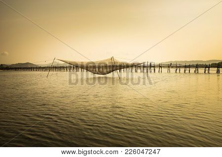 Panorama View Of Ong Cop Bridge With Big Fish Net Trap By Twilight Period, The Longest Wooden Bridge