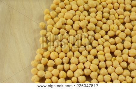 Close Up Of Canned Garbanzo Beans Vegetable With Wood Background