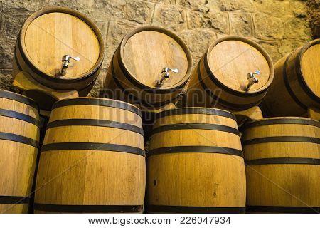Wine Barrels In Cellar. Wine Storage Place