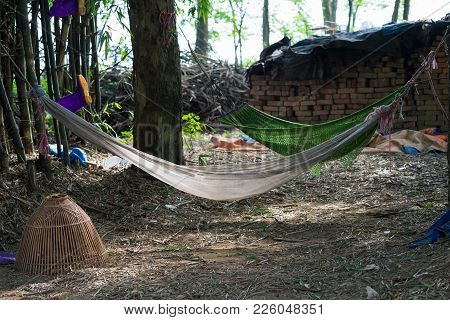 Old Hammock Hanging On Tree At Old Messy Countryside Place In Vietnam. Breaking Rest Place For Farme
