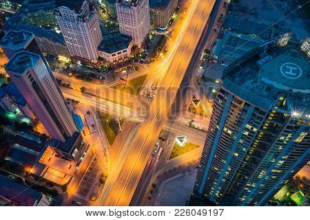 Aerial view of Hanoi cityscape at twilight period with skyscraper and intersection Pham Hung - Duong Dinh Nghe, Tu Liem district, Hanoi, Vietnam. Modern Hanoi city. poster