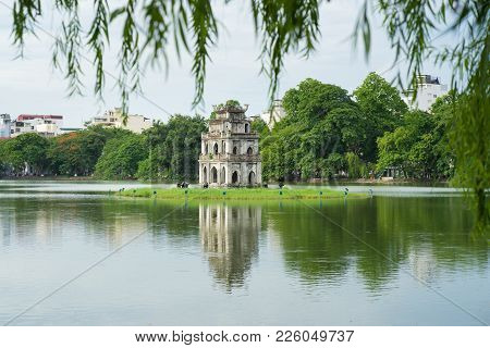 Hoan Kiem Lake Or Sword Lake, Ho Guom In Hanoi, Vietnam With Willow Branches On Foreground