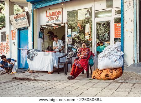 Manali, Himachal Pradesh, India  - August 27, 2016:  Female As A Street Laundry Service Customer Wai