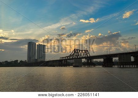 Panorama View Of Long Bien Ancient Metal Bridge Crossing Red River At Early Morning In Hanoi, Vietna