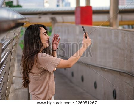 Young Asian Woman Making A Video Call Using Smartphone And Video Chat With Boyfriend On Mobile Phone