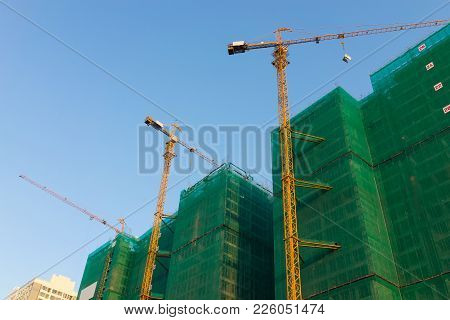 Under Construction Building With Finished Built Buildings