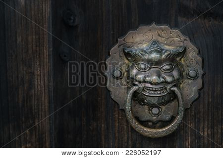 Old-fashioned Steel Knocker At The Wooden Door, Close Up