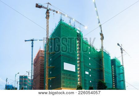 Under Construction Hight Apartment Building At Twilight
