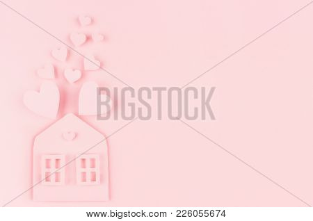 Family Hearth - Paper House With Flying Hearts On Soft Pink Color Background. Copy Space. Valentine