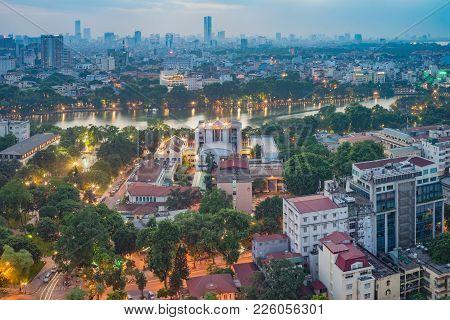 Aerial View Of A Hoan Kiem Lake Or Sword Lake, Ho Guom In Vietnamese At Night. Hanoi Skyline View. H
