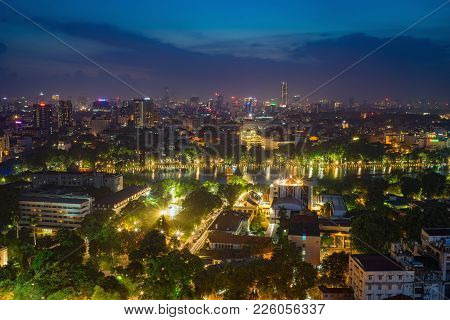 Aerial View Of A Hoan Kiem Lake Or Sword Lake, Ho Guom In Vietnamese At Night. Hanoi Skyline View. H