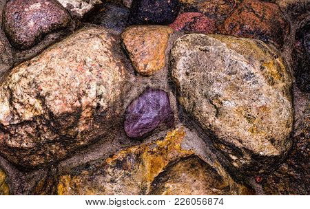 Decorative Wall Of Large Stones. Concreted Stones. Pebbles In The Wall. A Garden Wall. Decorative Su