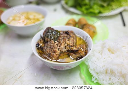 Bun Cha, A Vietnamese Famous Noodle Soup Of Grilled Pork And Rice Noodles Served With Fresh Herbs, D