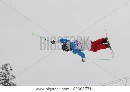 KRASNOE OZERO, LENINGRAD REGION, RUSSIA - FEBRUARY 1, 2018: Anton Latyshev of Russia competes in dual mogul during Freestyle Europa Cup competitions. Latyshev takes 16th place