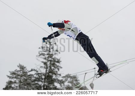 KRASNOE OZERO, LENINGRAD REGION, RUSSIA - FEBRUARY 1, 2018: Nikita Novitckii of Russia competes in dual mogul during Freestyle Europa Cup competitions. He fell and takes 15th place