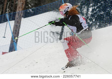 KRASNOE OZERO, LENINGRAD REGION, RUSSIA - FEBRUARY 1, 2018: Anastasia Kulikova of Russia competes in dual mogul during Freestyle Europa Cup competitions. Wallberg takes 5th place