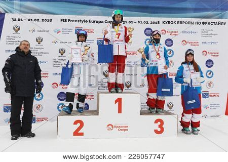 KRASNOE OZERO, LENINGRAD REGION, RUSSIA - FEBRUARY 1, 2018: Winners in dual mogul of Freestyle Europa Cup during award ceremony. On podium: Lundblad (2nd), Smirnova (1st), Kuznetsova (3rd)