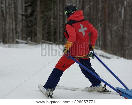 KRASNOE OZERO, LENINGRAD REGION, RUSSIA - FEBRUARY 1, 2018: Doctor on a slope during dual mogul competitions of Freestyle Europa Cup. Athletes from 7 countries participate in competitions