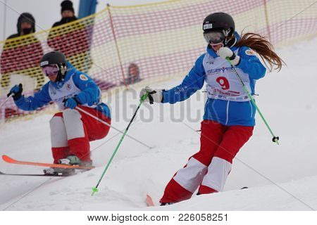 KRASNOE OZERO, LENINGRAD REGION, RUSSIA - FEBRUARY 1, 2018: Yelizaveta Bezgodova (in front) and Ksenia Kuznetsova, both of Russia, compete in dual mogul during Freestyle Europa Cup competitions