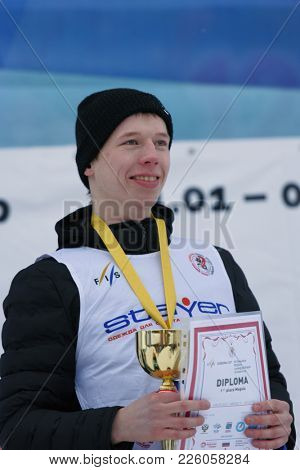 KRASNOE OZERO, LENINGRAD REGION, RUSSIA - FEBRUARY 1, 2018: Andrey Uglovski of Russia  got gold medal during award ceremony of mogul competitions during Freestyle Europa Cup