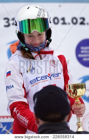 KRASNOE OZERO, LENINGRAD REGION, RUSSIA - FEBRUARY 1, 2018: Anastasiia Smirnova of Russia got gold medal during award ceremony of dual mogul competitions during Freestyle Europa Cup