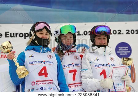 KRASNOE OZERO, LENINGRAD REGION, RUSSIA - FEBRUARY 1, 2018: Winners in dual mogul of Freestyle Europa Cup during award ceremony. Left to right: Kuznetsova, Smirnova, both of Russia, Lundblad, Sweden
